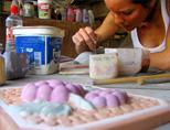 Volunteer painting her art
