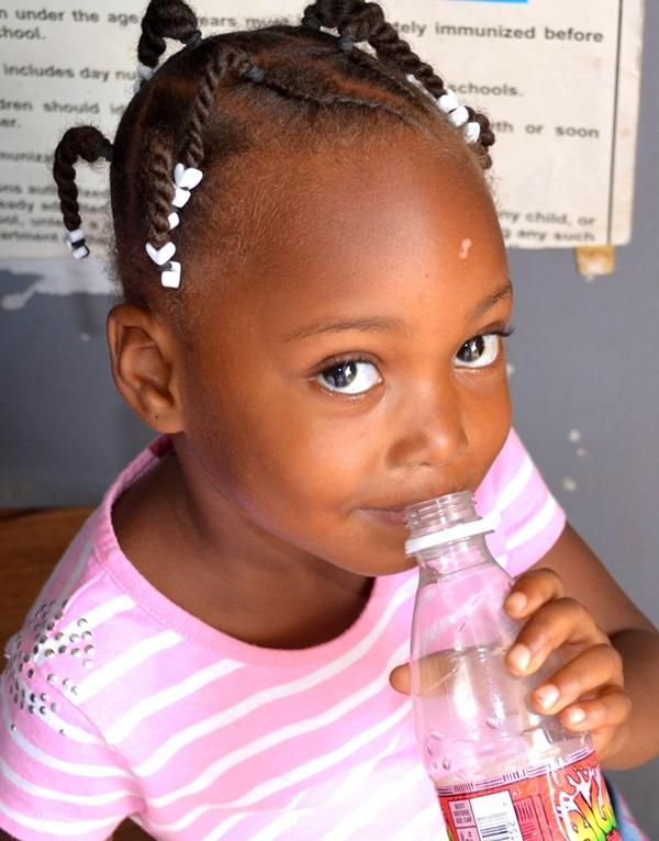 A young girl at the community outreach program in Placencia, Belize
