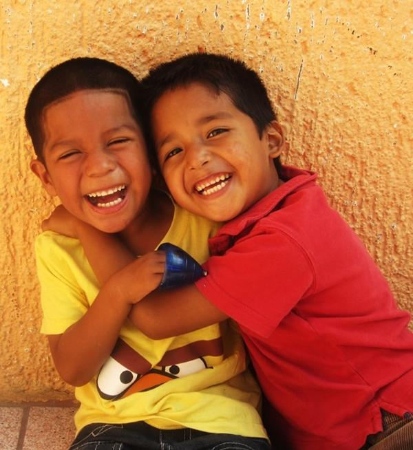 Two school boys pose for a picture during recess at a school in Belize