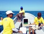 Scientists from our partner organization collect data out at sea in Belize.