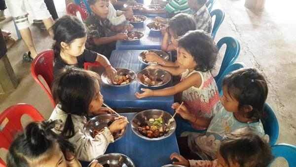 Cambodian children eating their meal