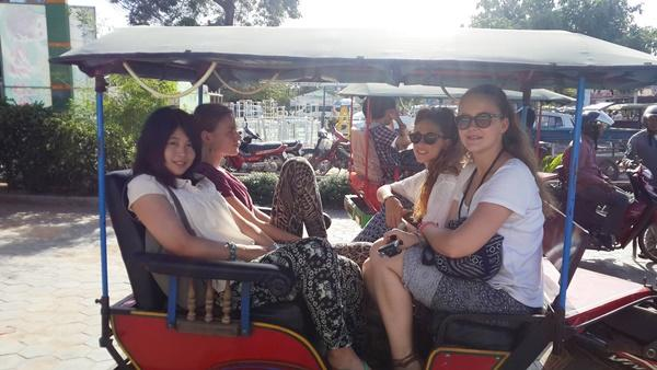 Female volunteers on a tuk-tuk in Cambodia