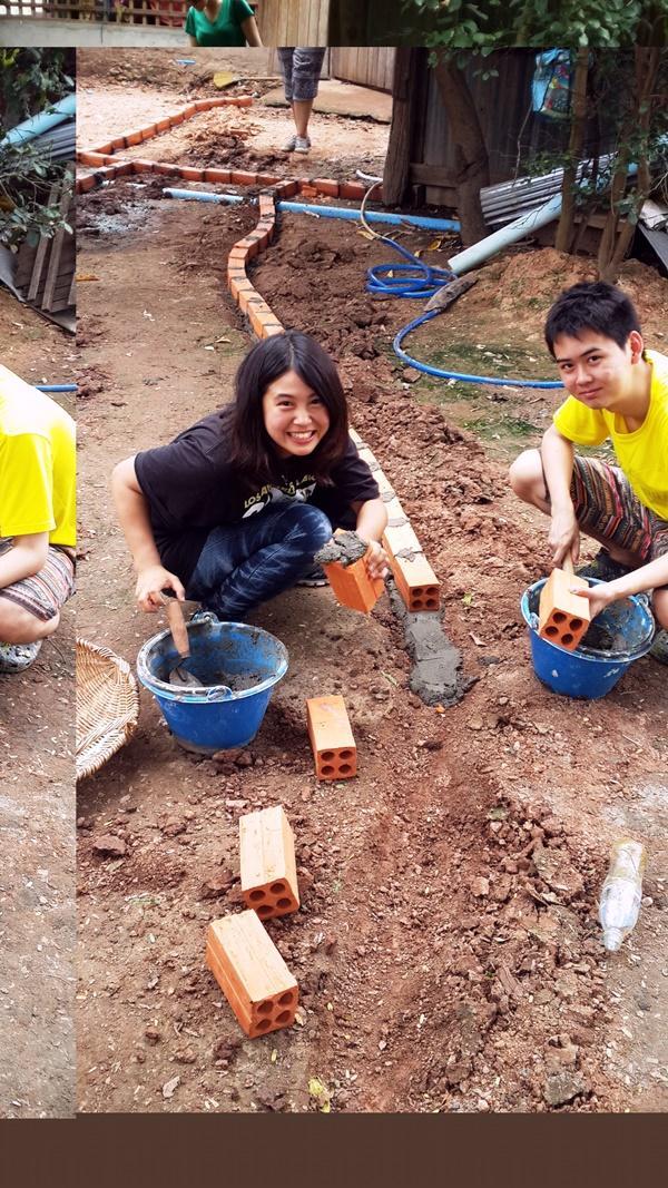 Japanese teenage volunteers working on building
