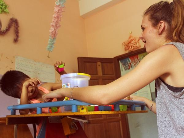 Occupational Therapy intern works with child in Cambodia