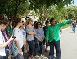 Cambodian local guide explaining to high-school volunteers