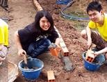 Japanese teenage volunteers working on building