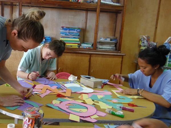 Volunteers put together arts & crafts for a presentation for children