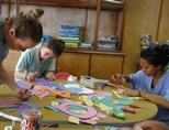 Volunteers put together arts & crafts for a presentation for children