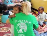 A volunteer hugs a child at a care centre in Ethiopia