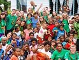 Volunteers take a picture with Projects Abroad staff and local Fijian people