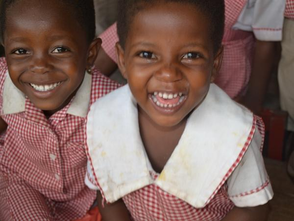Two Ghanaian students smile for the camera
