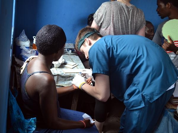 A Public Health intern treats a local during an outreach activity