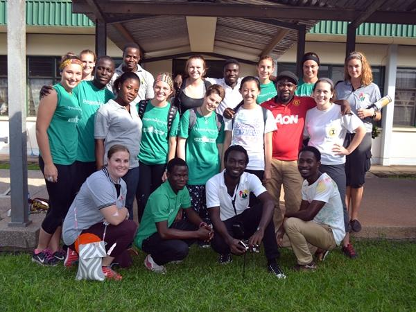 A group of volunteers take a photograph at a hospital in Ghana