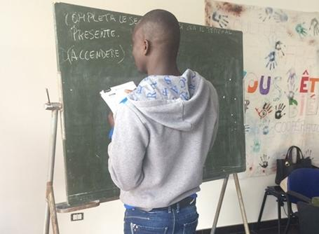 A refugee learns Italian at a center in Calabria, Italy.