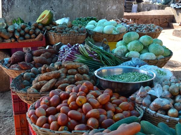 Baskets of fresh fruit and vegetables for sale in a local Jamaican market