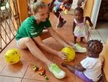 Care volunteers plays with Jamaican children