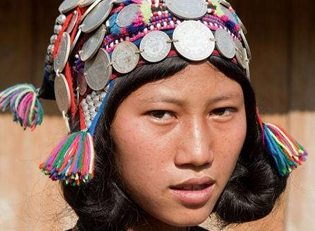 A teenage girl dressed in traditional clothing in Laos.