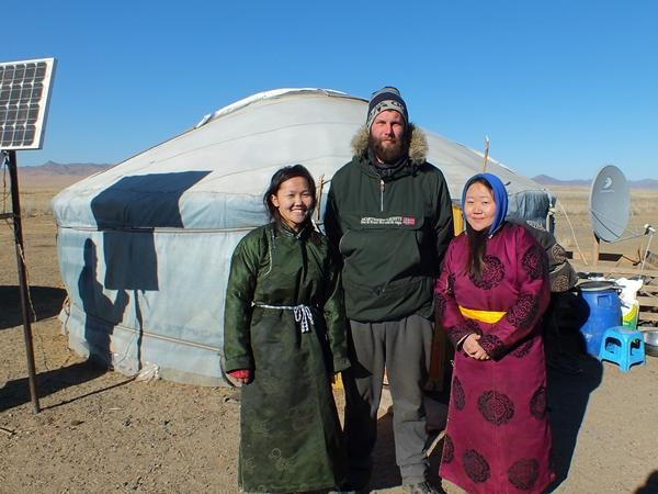 Male volunteer with a host family in Mongolia