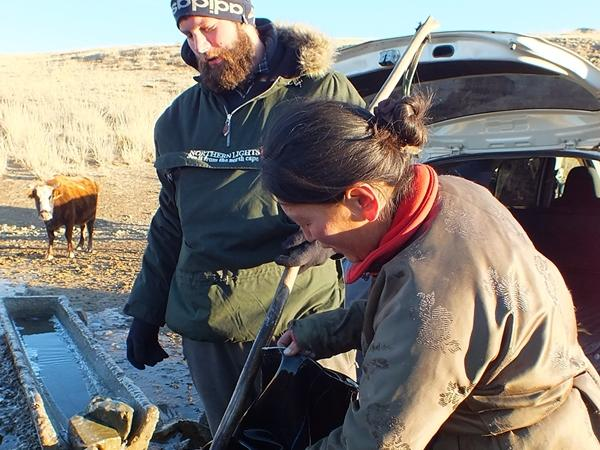Male volunteer interacting with a local woman in Mongolia