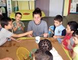 A volunteer enjoys an arts & crafts activity with young children in Morocco