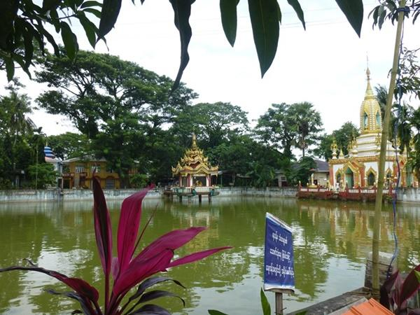 A lake and shrine at the Dala Monastery in Myanmar, Asia.