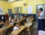 A local teacher leads a class at a school in Myanmar, Asia.