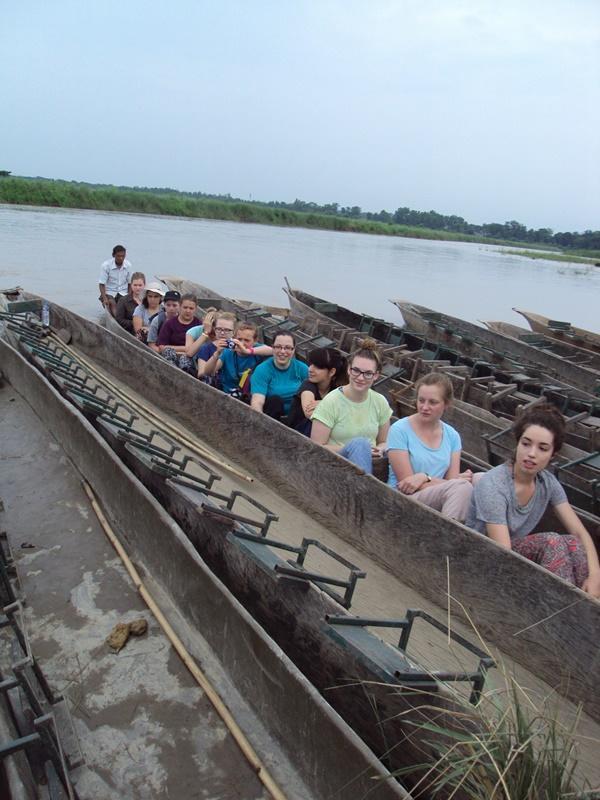 High School Volunteers in Nepal on a narrow boat