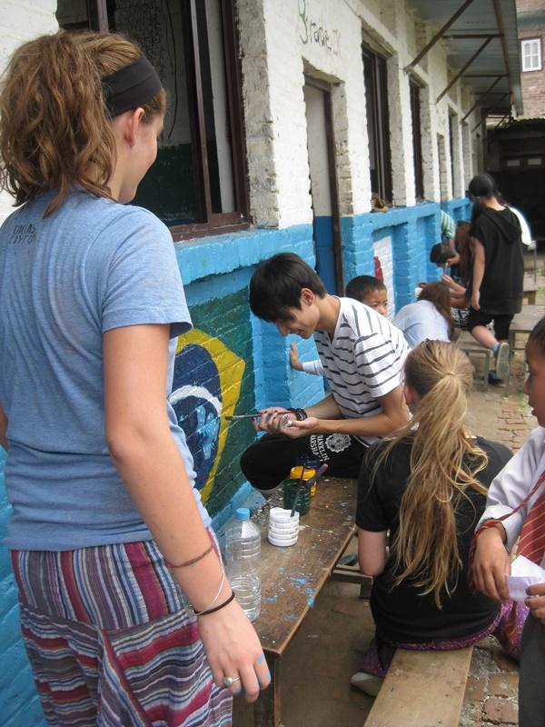 High School Special volunteers repainting a school in Nepal, Asia