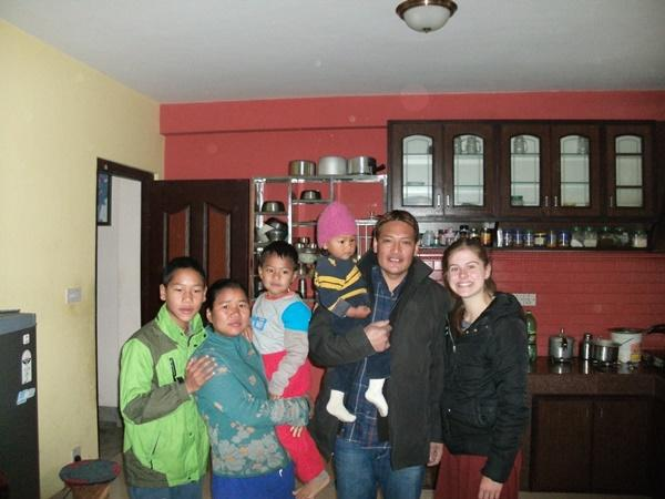 A volunteer with her host family in Nepal.