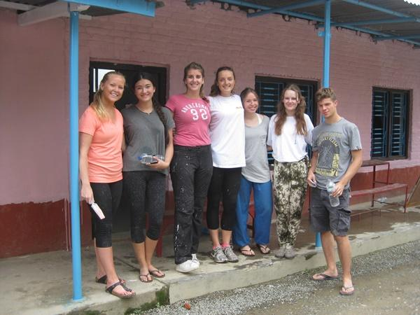 High School Special volunteers take a break from painting a school in Nepal, Asia