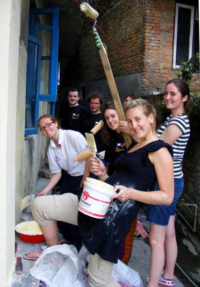Volunteers painting a school