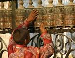 Child at a prayer wheel