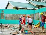 Volunteers work hard on-site at the Disaster Relief project in the Philippines