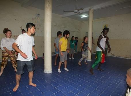 Volunteers learning african dance