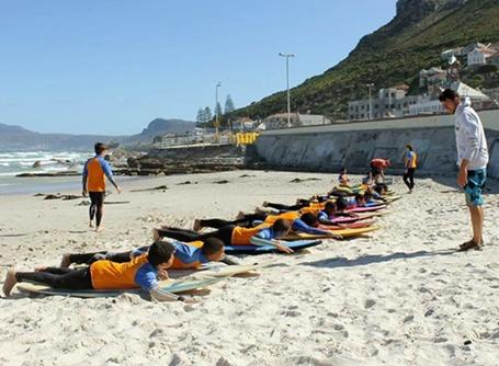 Volunteer with children at a surf project in South Africa