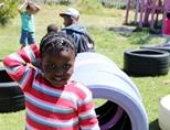 A smiling child at a Care placement in Cape Town