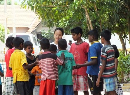 Japanese volunteer busy in a medical awareness project in Sri lanka
