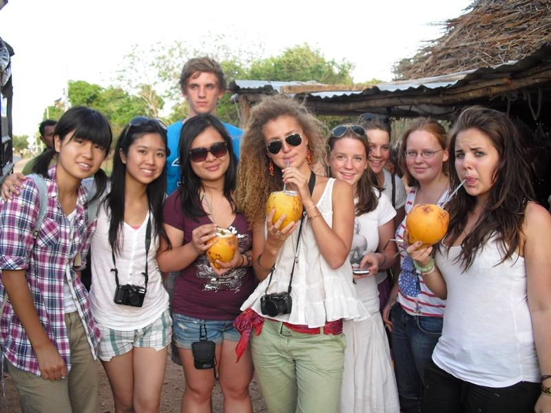 Female volunteers drinking local juice in Sri Lanka