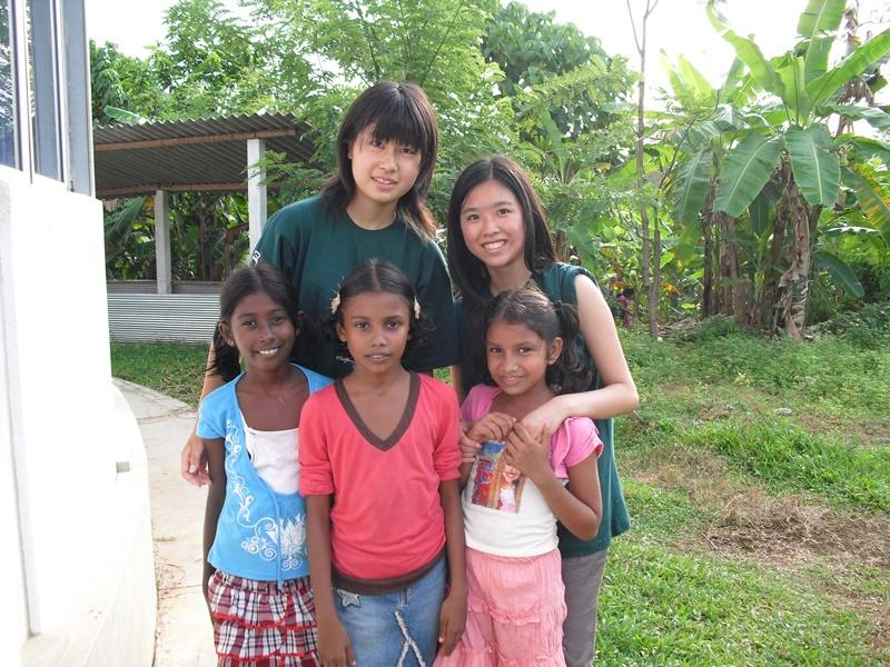 Japanese female volunteers with sri-lankan kids