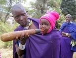 A Maasai woman feeds her baby girl in a local village in Tanzania