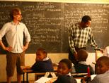 Volunteer assisting a teacher in Tanzania