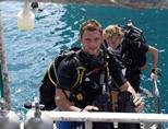 Marine conservation volunteer about to take part on a dive in Thailand