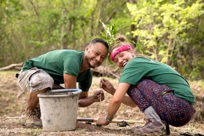 A Projects Abroad conservation volunteer plants native tree species with a staff member in Barra Honda National Park
