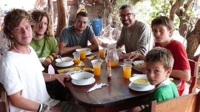 A family have lunch together before getting back to volunteer work on their service-learning trip to Ecuador.