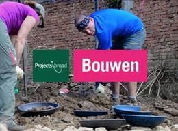 Vrijwilligerswerk op een Bouw project