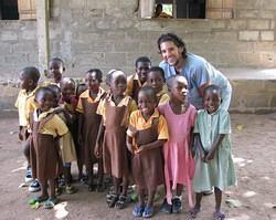 Alex with children at outreach programme