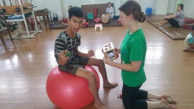 Alice working with a patient at her Physiotherapy placement
