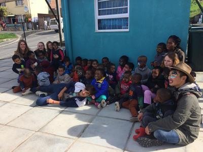 Volunteers spending time with local children