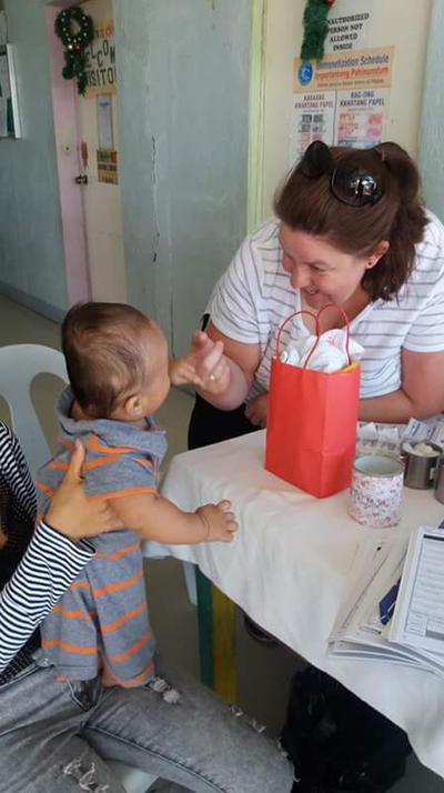 A volunteer plays with a baby