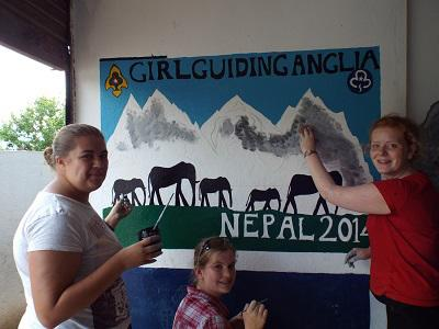 Girl guides painting at the school